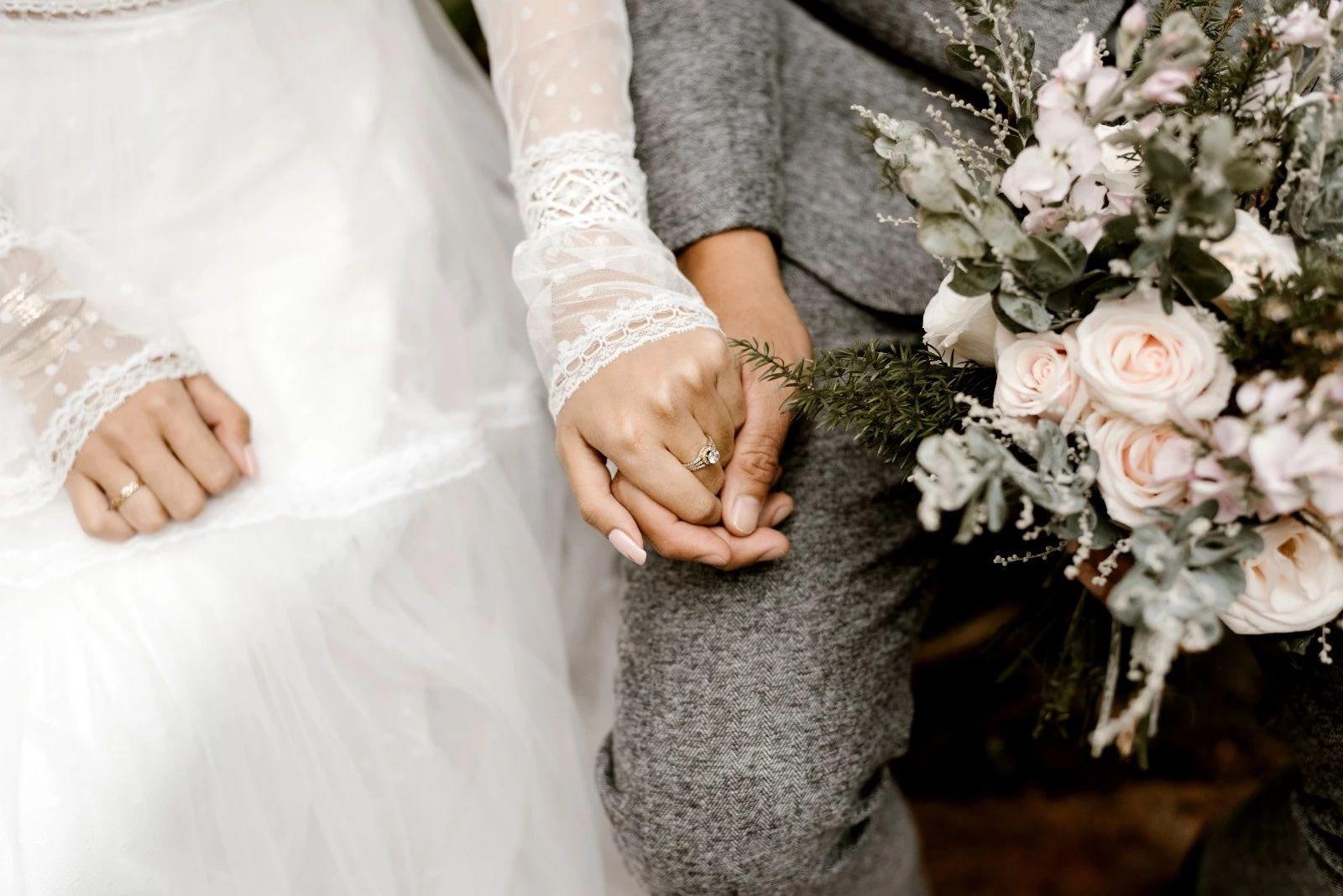 bride-and-groom-holding-hands-2959190.jpg